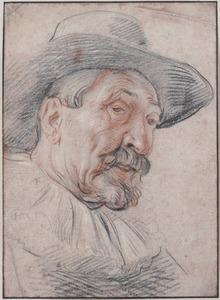 Kop van een man met brede hoed