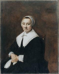 Portret van een zittende 47-jarige vrouw