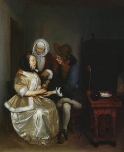 Jonge vrouw, jonge man en een koppelaarster in een interieur