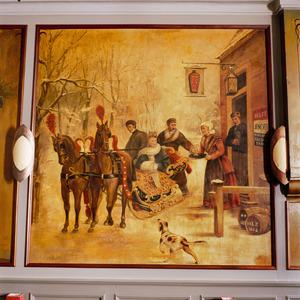 Herberg met een gezelschap van mannen en vrouwen rond een arrenslee