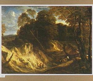 Heuvellandschap met herders en reizigers in een droogstaande rivierbedding
