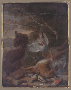 Hond bij jachtbuit in een boslandschap