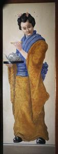 Chinese vrouw die thee serveert