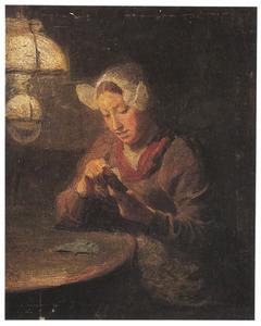 Jonge vrouw uit Holland in klederdracht bij het kaartspel