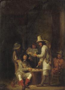 Gezelschap van kaartspelende mannen in een interieur