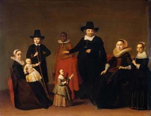 Portret van een familie met hun bediende
