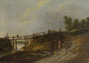 Duinlandschap met een houten brug
