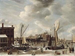 Winters gezicht op de Nieuwe Brug en het Paalhuis in Amsterdam