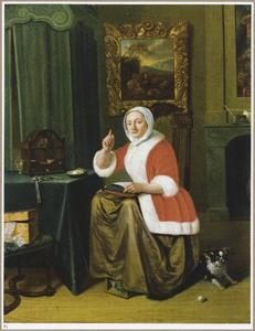 Handwerkende jonge vrouw in een interieur