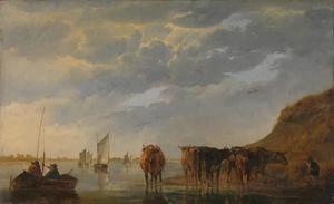 Herder met vijf koeien bij een rivier