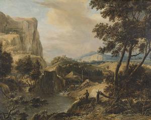 Visser bij een woeste bergrivier met waterval