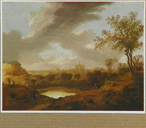 Duinlandschap met ruiter; op de achtergrond Haarlem