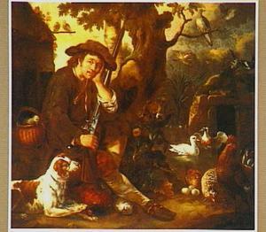Zittende jager bij een boom met een hond en vogels