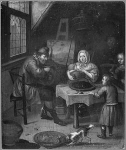 Een arme schilder met zijn gezin in een interieur