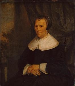 Portret van een zittende oude vrouw