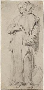 Monnik met een mijter aan zijn voeten