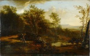 Bosachtig landschap met ruiter bij een rivier