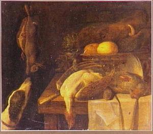 Stilleven op tafel met kop van everzwijn, links een hond