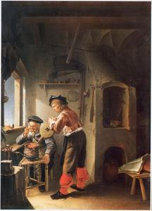Alchemist met assistent in zijn werkplaats