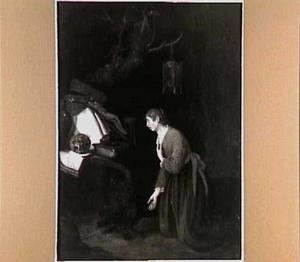 Een biddende vrouw in een landschap
