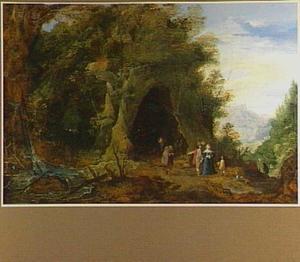 Landschap met een elegant gezelschap bij een kapel in een grot
