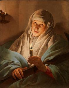 Vrouw met houten kruis en een brandende kaars