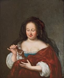 Jonge vrouw die een schoothondje plaagt