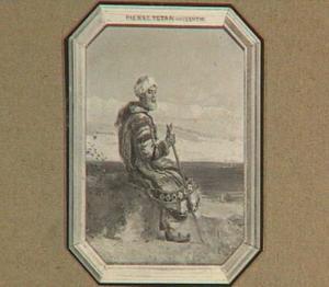 Man in arabische dracht, zittend aan zee