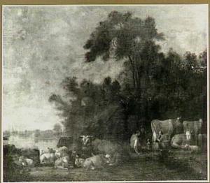 Landschap met grazend vee op de oever van een rivier