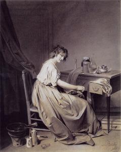 Een jonge vrouw maalt koffie