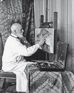 Bernard Wierink in zijn atelier aan het schilderen