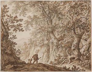 Boslandschap met twee wandelaars op een pad