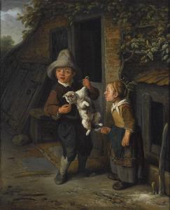 Een jongen en een meisje die een kat plagen