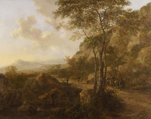 Berglandschap met reizigers op een pad