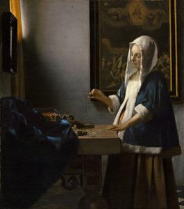 Vrouw met een weegschaal
