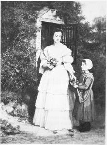 Vrouw en kind met bloemen in de hand in een tuin