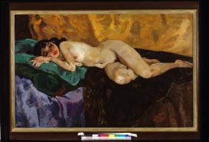 Naakte vrouw liggend op bed
