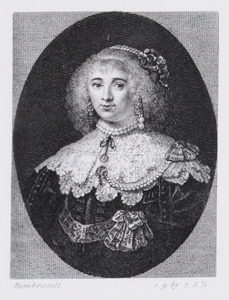 Portret van een vrouw met bloemen in het haar