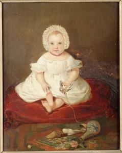 Portret van een kind gezeten op een kussen