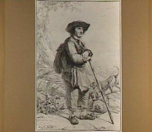 Staande man met wandelstok en twee honden