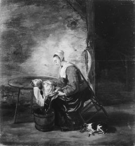 Interieur met een plukkende vrouw en slapende hond