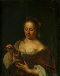 Vrouw die haar schoothondje plaagt