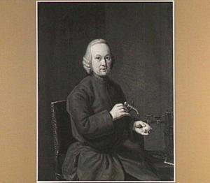 Portret van een man gezeten bij een werktuig