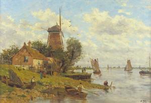 Schepen op een rivier bij een molen