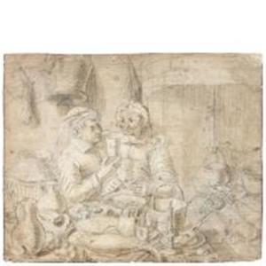 Man en vrouw zittend aan tafel in een keuken
