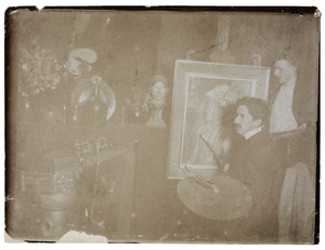 Piet Mondriaan schilderend in zijn atelier en een onbekende man
