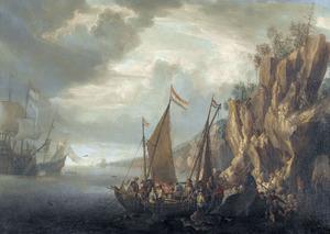 Kustgezicht met schepen bij een rotswand
