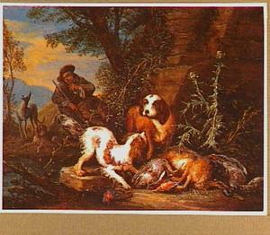 Honden en jager bij jachtbuit van haas en gevogelte in een landschap
