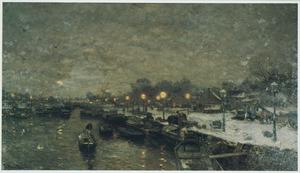 Hollands stadsgezicht met kanaal in de winter
