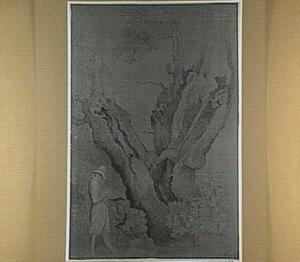 Landschap met tekenaar voor een gespleten boom